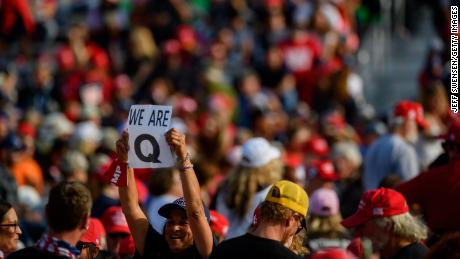 A woman holds up a QAnon sign at a President Trump campaign rally on September 22, 2020, in Moon Township, Pennsylvania.
