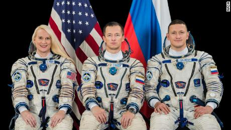 NASA astronaut and Russian cosmonauts launch into space station