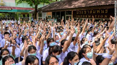 During a protest in Bangkok on October 2, 2020, students give a three-finger salute to Samson School for less stringent school rules, more tolerance and respect.