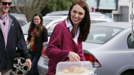 Labour Leader Jacinda Ardern arrives with scones as she visits Labour Election Day volunteers in Auckland on October 17, 2020.