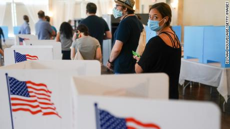 People wait in line to vote in Georgia's Primary Election on June 9 in Atlanta.