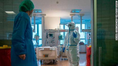 Healthcare workers tend to Covid-19 patients at the intensive care unit at Thomayer Hospital in Prague on October 14, 2020.