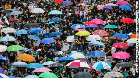 Protesters wearing face masks gather with their umbrellas during a demonstration in Nonthaburi province.