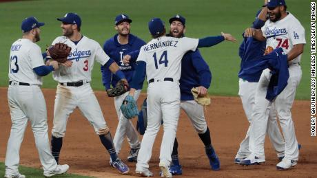 The Dodgers celebrate after beating the Braves.