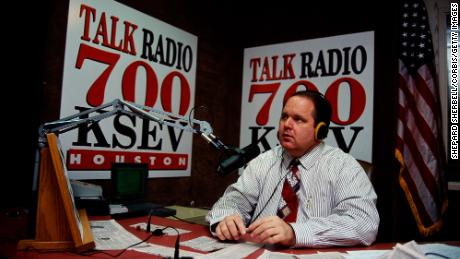 Rush Limbaugh sits at his desk at Talk Radio 700 KSEV during the Republican National Convention in Houston.  (Photo by Shepard Sherbell / Corbis / Getty Images)