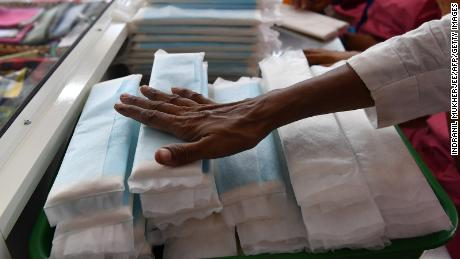 Employees of Myna Mahila Foundation, an Indian charity championing menstrual hygiene, prepare sanitary pads at their office in Mumbai on April 10, 2018.