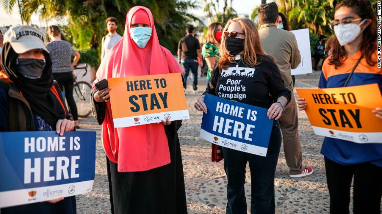 Demontrators hold signs in support of the Supreme Court's ruling in favor of the Deferred Action for Childhood Arrivals program in San Diego, California, on June 18.