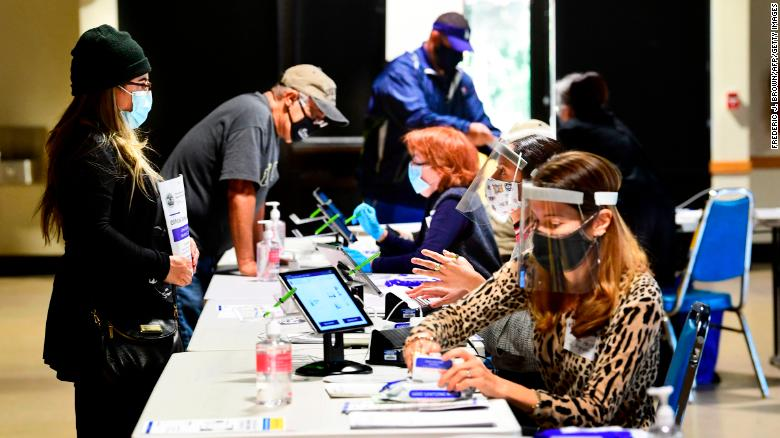 Voters check in with election officials in Arcadia, California, on October 26.