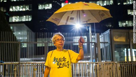 Alexandra Wong poses next to the government headquarter's driveways in Hong Kong, on the eve of the second anniversary of the Umbrella Movement.