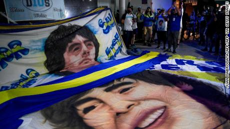 Supporters Diego Maradona gather outside the hospital where he underwent successful brain surgery for a blood clot.