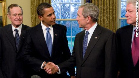 U.S. President George W. Bush shakes hands with President-elect Barack Obama, as former President Bill Clinton, and former President George H.W. Bush look on in the Oval Office January 7, 2009 in Washington, DC. (Photo by Ron Sachs-Pool/Getty Images)