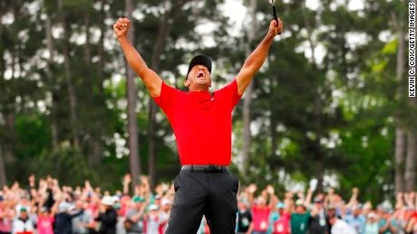 Tiger Woods celebrates after sinking his putt on the 18th green to win the Masters.