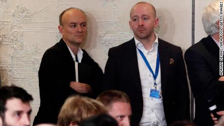 Dominic Cummings, left, and Lee Cain, right, attend a press conference by Boris Johnson in December 2019 in Watford, England.