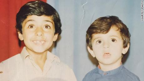 Naser Alazari, right, is photographed with his brother, Sayf, while living in Iraq.