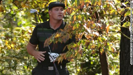 Bryson DeChambeau  played his second shot from the trees on the 11th hole at Augusta.