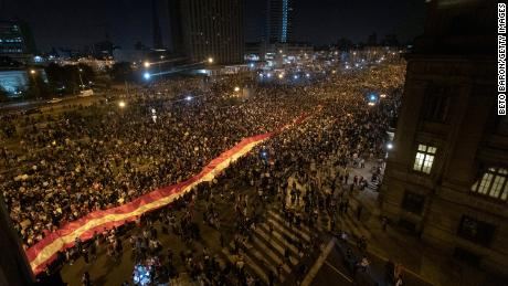 Protesters against the removal of President Martin Vizcarra march with a giant national flag as they gather in front of Palacio de Justicia on November 14, 2020 in Lima, Peru.