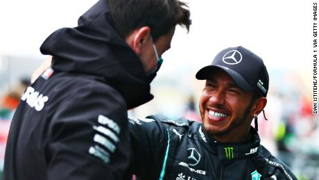 Hamilton with Mercedes chief Toto Wolff.