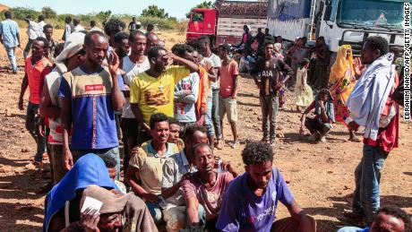 Ethiopian refugees fleeing Tigray line up to receive supplies at the Um Rakuba camp in Sudan's eastern Gedaref province, on November 16, 2020.