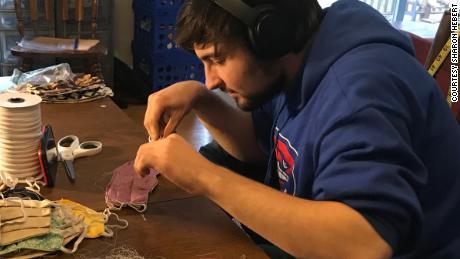 Walter Hebert, Sharon's son, hard at work on the masks
