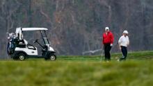 President Donald Trump plays golf in Sterling, Virginia on Saturday, November 21, 2020.