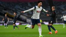 Son celebrates after scoring against Manchester City.