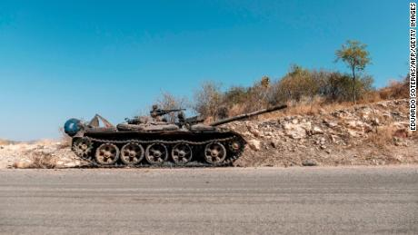 A damaged tank stands abandoned on a road near Humera, Ethiopia, on November 22, 2020