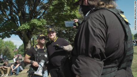 Proud Boys chairman Enrique Tarrio poses with a Proud Boys member at a rally in Delta Park in Portland, Oregon, on September 26, 2020.