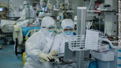 Medical personnel work in the intensive care unit at a Wuhan hospital on February 24.