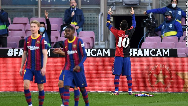 Lionel Messi celebrates after scoring in memory Diego Maradona.