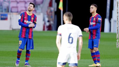 Messi and Dest stand for a minute of silence in tribute to Diego Armando Maradona during the La Liga match between Barcelona and Osasuna.
