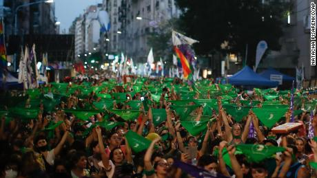 Abortion-rights supporters rally Thursday outside Argentina's Congress with green handkerchiefs associated with the movement to decriminalize abortion.