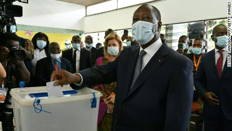 Ouattara casting his ballot at a polling station in Abidjan on October 31, during Ivory Coast's presidential election.