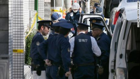 Police officers prepare to inspect an apartment in Zama, Kanagawa prefecture, on November 2, 2017, where police found nine dismembered bodies.