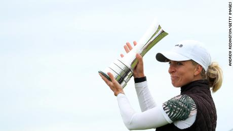 Popov lifts the trophy following victory at the Women's British Open.