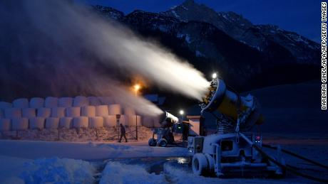 Snow cannons blow snow on the hills in the Abtenau ski resort on December 1.