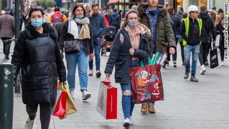 Pedestrians walk along a busy shopping street in Dublin on December 1