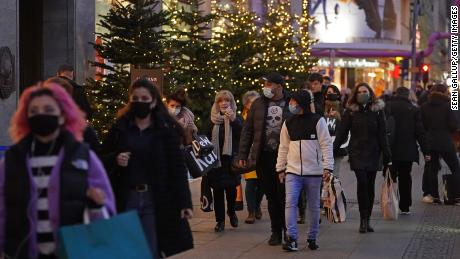 Shoppers crowd under Christmas lights in Berlin on December 15.