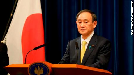 Japanese Prime Minister Yoshihide Suga speaks during a news conference after a Parliament session in Tokyo on December 4, 2020.