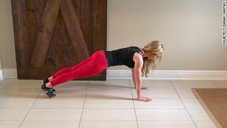 Fitness expert Dana Santas demonstrates push-ups, which builds upper body strength.