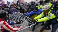 Trump supporters try to break through a police barrier on January 6 at the Capitol in Washington.