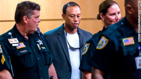 Woods (C) appears in Palm Beach County court October 27, 2017 in Palm Beach Gardens, Florida. He later pled guilty to a second-degree misdemeanor reckless driving charge.