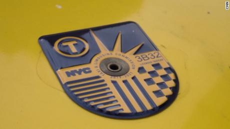 A taxi medallion.