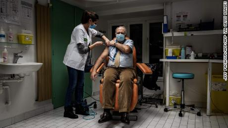 A member of the medical staff at a hospital in Lyon, France receives the Pfizer/BioNTech vaccine on January 6.