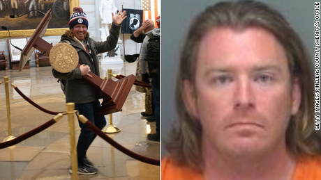 Adam Johnson was arrested and booked days after he carried the House speaker's lectern during the riot.