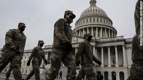 DC Mayor urges people to avoid nation's capital as Secret Service begins preparations for grand opening and 15,000 troops may arrive in city