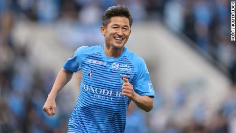 Miura smiles while on the pitch for Yokohama FC against Vissel Kobe