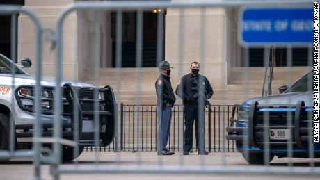Georgia State Troopers stand guard in front of the Capitol on the first day of the legislative session in Atlanta on Monday.