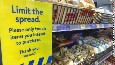 Sign urging customers to only touch items they intend to purchase from a Walmart store during the novel coronavirus pandemic in Toronto, Ontario, Canada, Jan.8, 2021.