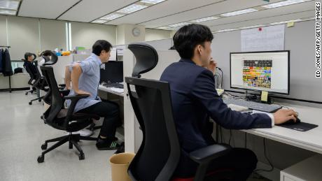 Workers at the office of the Korea Communications Standards Commission (KCSC) in Seoul on November 8, 2019, where staff are tasked with hunting down and removing internet sex videos posted without consent.