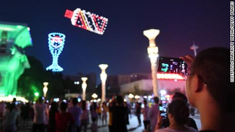 """800 drones perform in teams in the night sky to form a """"Moutai wine bottle"""" pattern in Renhuai, Guizhou, China in June 2020."""